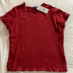 maroon t-shirt with ruffle sleeves